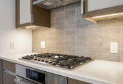 Custom Stained Wood Kitchen Cabinets with quartz countertops